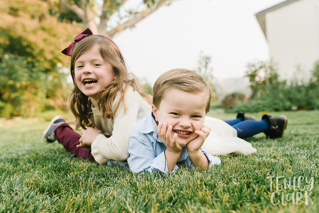 Sibling dog pile. Lifestyle in-home family photoshoot in Marin, CA by Tenley Clark Photography.