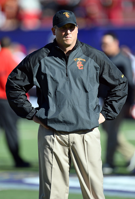 . LAS VEGAS, NV - DECEMBER 21:  USC Trojans interim coach Clay Helton watches his team warm up before playing the Fresno State Bulldogs in the Royal Purple Las Vegas Bowl at Sam Boyd Stadium on December 21, 2013 in Las Vegas, Nevada. USC won 45-20.  (Photo by Ethan Miller/Getty Images)