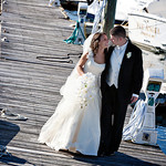 A bride a groom after their Cape Cod wedding at Nauticus Marnia. Photo by Bello Photography - The Casual Gourmet, Cape Cod Wedding Caterer
