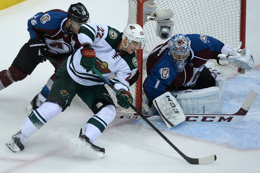 . DENVER, CO - APRIL 26: Nino Niederreiter (22) of the Minnesota Wild works for a shot against Semyon Varlamov (1) of the Colorado Avalanche during the second period. The Colorado Avalanche hosted the Minnesota Wild during game five of the first round of the NHL Stanley Cup Playoffs at the Pepsi Center on Saturday, April 26, 2014. (Photo by Karl Gehring/The Denver Post)