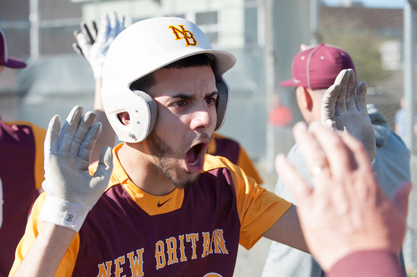 04/23/18 Wesley Bunnell | Staff New Britain baseball defeated Southington 9-8 in extra innings on Monday afternoon in a contest played at Southington High School. Guillermo Burgos (3) is fired up while congratulating teammates after he came home to score.