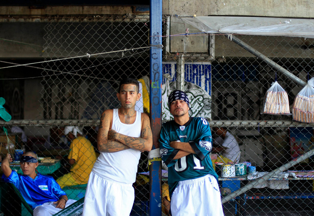 . Jailed gang members stand inside the maximum security jail of Izalco in Sonsonate March 5, 2013. Jailed members of the country\'s two most powerful gangs MS-13 and the 18th Street gang (Mara 18), members of civic organizations and Bishop Fabio Colindres celebrated mass to mark the first anniversary since the two gangs signed a truce in March 2012 in an effort to reduce violent crimes in the country.     REUTERS/Ulises Rodriguez