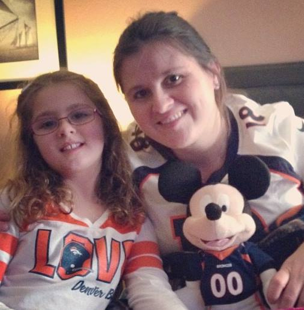 . Rooting on the Broncos while we craft Bronco bracelets together. (Photo by Angela Hopwood)
