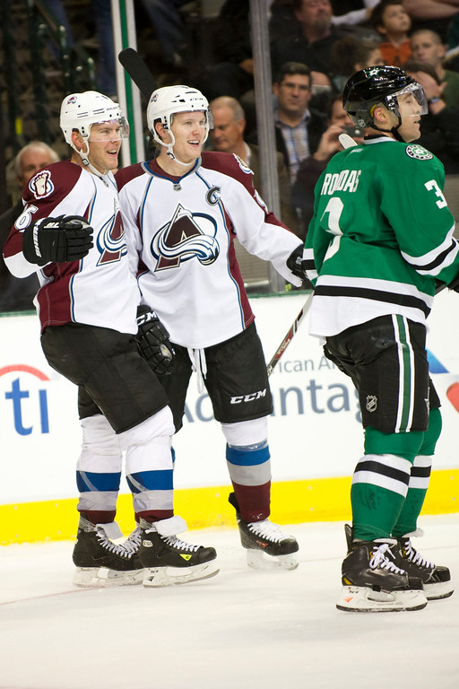 . DALLAS, TX - NOVEMBER 1:  Gabriel Landeskog #92 of the Colorado Avalanche celebrates with teammate Paul Stastny #26 after scoring a goal against the Dallas Stars on November 1, 2013 at the American Airlines Center in Dallas, Texas.  (Photo by Cooper Neill/Getty Images)