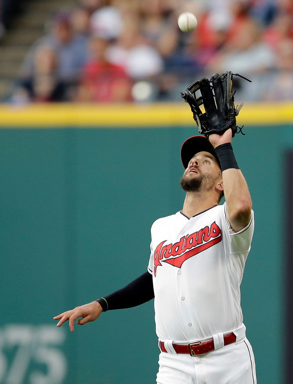 . Cleveland Indians\' Lonnie Chisenhall catches a ball hit by San Diego Padres\' Manuel Margot in the fifth inning of a baseball game, Wednesday, July 5, 2017, in Cleveland. Margot was out on the play. (AP Photo/Tony Dejak)