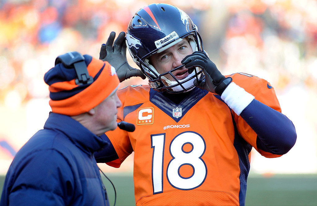 . Denver Broncos quarterback Peyton Manning with John Fox in the second quarter against the Tennessee Titans at Sports Authority Field at Mile High. (Photo by Steve Nehf/The Denver Post)
