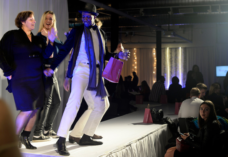 . After the runway show Anthony Langram leads the dancing on the runway at the second annual Westword Whiteout Fashion Show at the McNichols Building in Denver feature Denver designers on Thursday, January 30, 2014.  (Denver Post Photo by Cyrus McCrimmon)