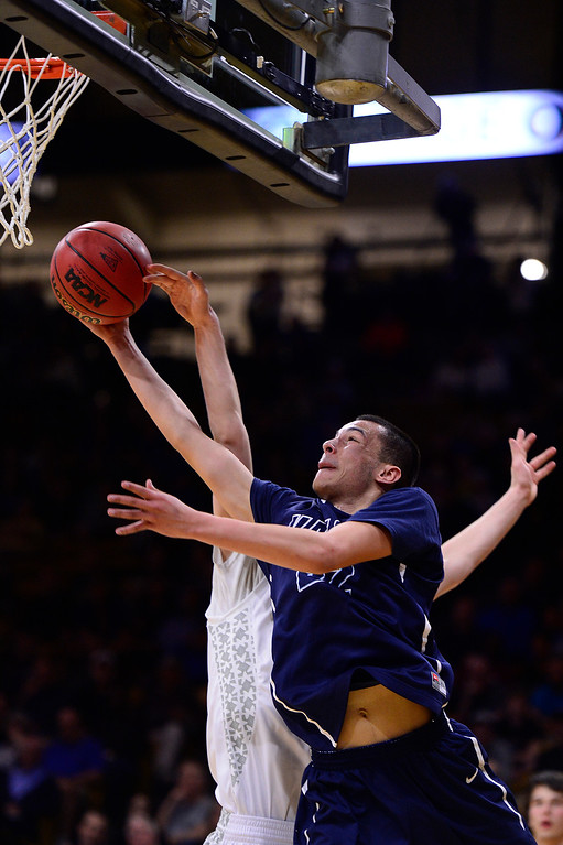 . Jalen Sanders (22) of Valor Christian gets his lay up swatted by Ryan Rulon (20) of Longmont during the second quarter at the Coors Events Center on March 11, 2016 in Boulder, Colorado. Pueblo West defeated Vista Ridge 65-54 to advance to the 4A finals of Colorado state basketball tournament.  (Photo by Brent Lewis/The Denver Post)