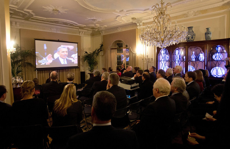 . Guests of American Ambassador Philip Murphy, unseen, watch the swearing-in ceremony ofUS President Barack Obama on a television screen at the guest house of the US Embassy in Berlin,�Germany, Monday, Jan. 21, 2013. (AP Photo/dpa, Christian Charisius)