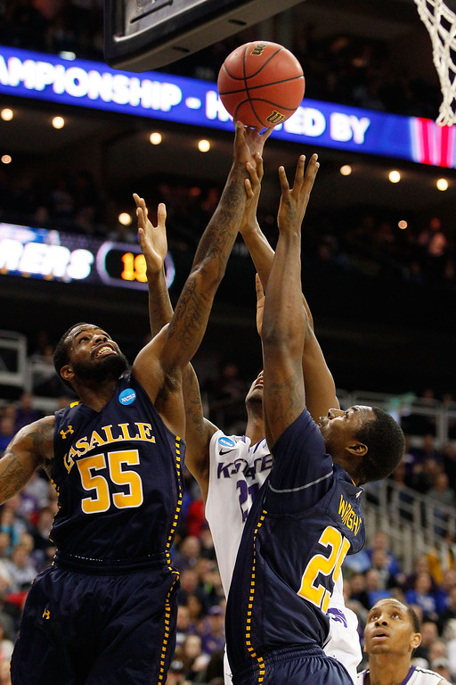 . KANSAS CITY, MO - MARCH 22: Ramon Galloway #55 and Jerrell Wright #25 of the La Salle Explorers rebound against Jordan Henriquez #21 of the Kansas State Wildcats in the first half during the second round of the 2013 NCAA Men\'s Basketball Tournament at the Sprint Center on March 22, 2013 in Kansas City, Missouri.  (Photo by Ed Zurga/Getty Images)