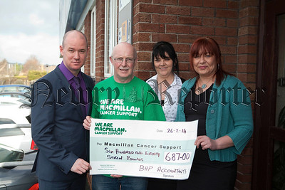Staff from BHP Accountants recently held a coffee morning and raised £687 for Macmillan Cancer Support. Pictured with Aiden Carroll are Adrian patterson, Marie McCabe and Teresa Byrne from BHP Accountants. R1410001