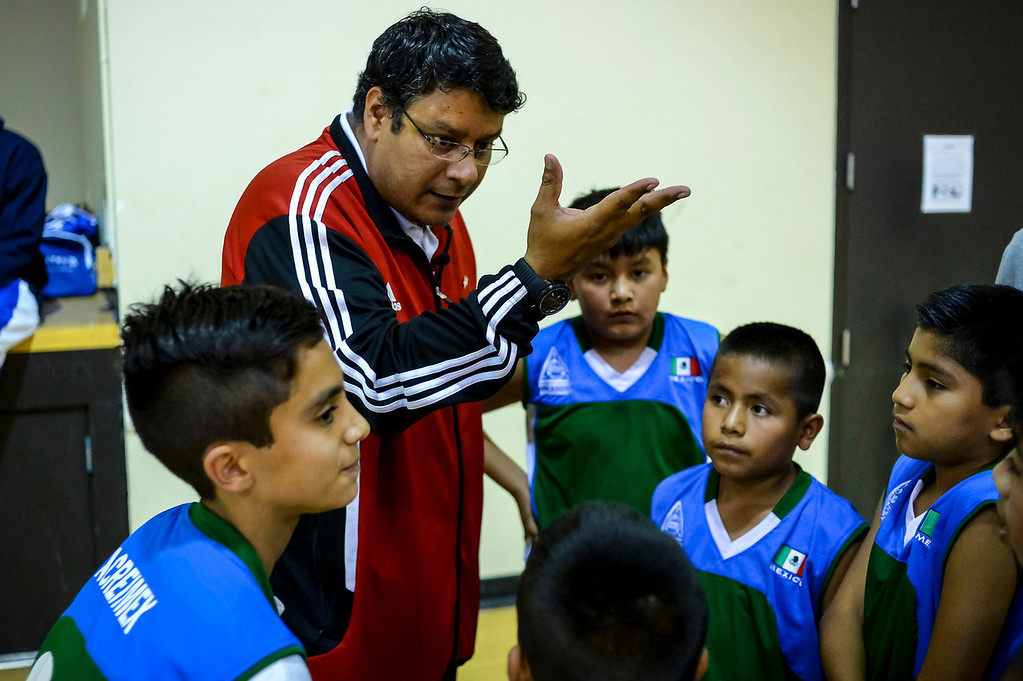 ". Triqui kids basketball team, from the mountainous region of Oaxaca, Mexico, who have been called the ""Barefoot Champions of the Mountain,\"" are known throughout their native Mexico for playing basketball without shoes took on the local Top Flight boys team at the Pacific Boys Lodge in Woodland Hills, CA Wednesday, December 18, 2013.  Here, the Triqui coach fires up his team.  (Photo by David Crane/Los Angeles Daily News)"