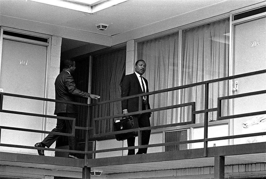 . Rev. Martin Luther King, Jr. is pictured walking across the balcony of the Lorraine Motel in Memphis, Tenn. at approximately the spot where he was shot by a hidden assassin.  This picture was made, April 3, 1968, the day before the shooting, shortly after King arrived in Memphis.  (AP Photo/stf )