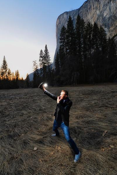Below El Capitan, Aaron takes a photo of me with remote flash