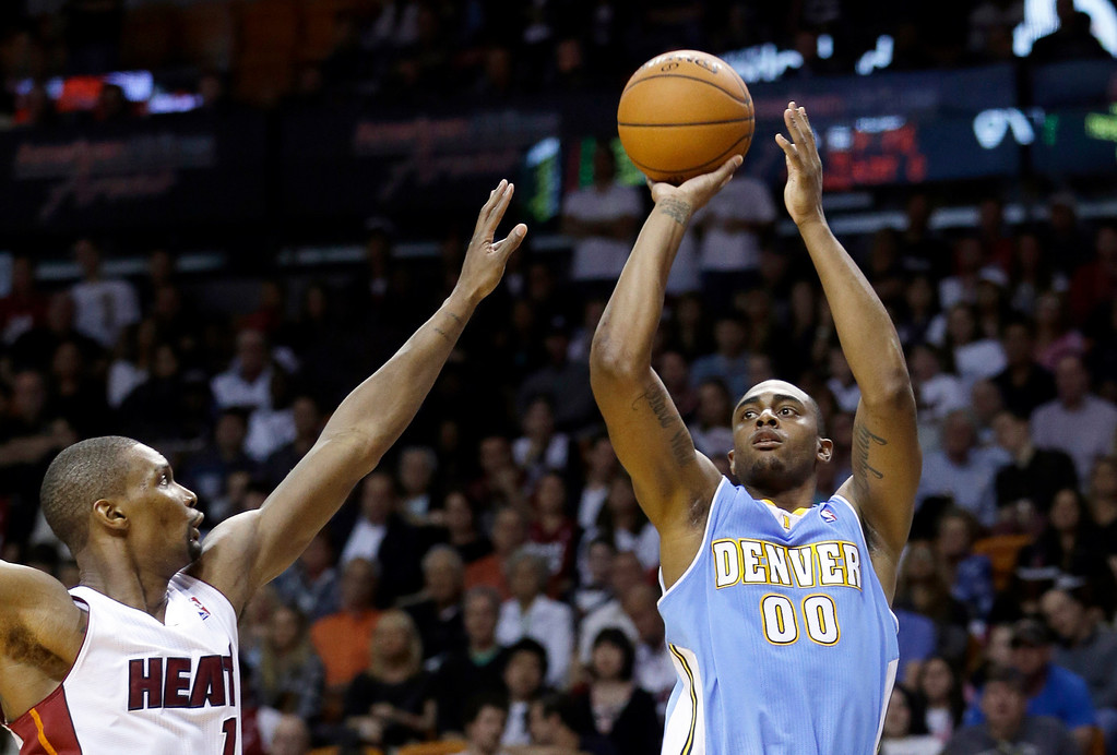 . Denver Nuggets forward Darrell Arthur (00) prepares to shoot against Miami Heat forward Chris Bosh (1) during the second half of an NBA basketball game in Miami, Friday, March 14, 2014. The Nuggets won 111-107. (AP Photo/Alan Diaz)