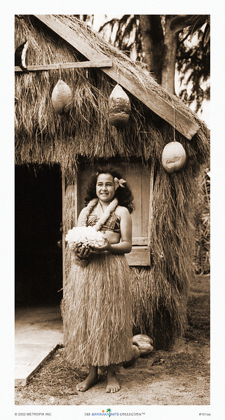 191: 'Going Native.' Tourist Posing by Grass Shack. Photograph; ca 1938. Of course, you can imagine the thousands of pictures taken in which tourists dress up (or one might say, dress down) like 'natives.' This sepia-toned photograph of a woman in hula attire is a charming example of a print that fits contemporary as well as classical decor.