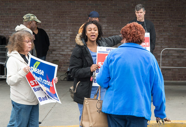04/11/19 Wesley Bunnell | Staff Stop & Shop workers on strike stand near the entrances to the store in New Britain on Thursday afternoon. Heather White, center, speaks with a woman who was entering the store to use the Peoples Bank on premise.