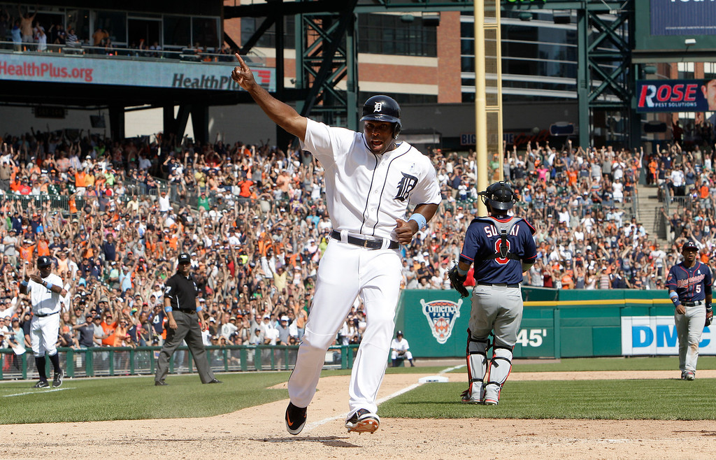 . Detroit Tigers\' Torii Hunter celebrates as he scores on a J.D. Martinez walkoff sacrifice fly against the Minnesota Twins in the ninth inning of a baseball game in Detroit, Sunday, June 15, 2014. Detroit won 4-3. (AP Photo/Paul Sancya)