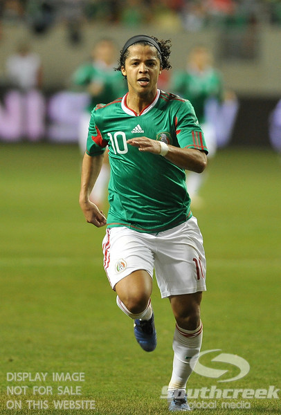 Mexico's Forward Giovani Dos Santos (#10) is in full pursuit of the ball during Soccer action between Bosnia-Herzegovina and Mexico.  Mexico defeated Bosnia-Herzegovina 2-0 in the game at the Georgia Dome in Atlanta, GA.