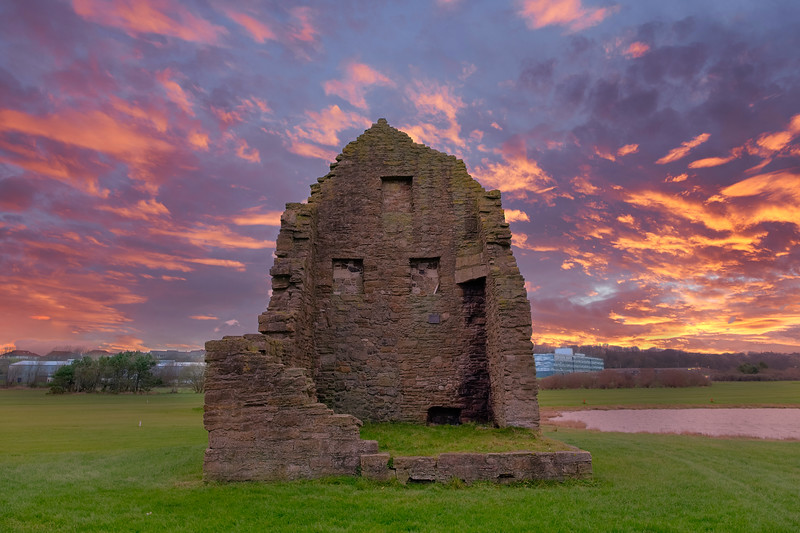 Auchenharvie Colliery Engine House Remains Stevenston North Ayrshire Scotland At Sunset With a Blazing red Dramatic Sky.