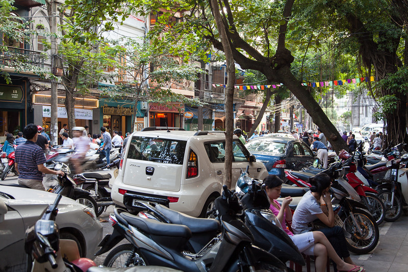 A busy street just after school lets out in Hanoi.