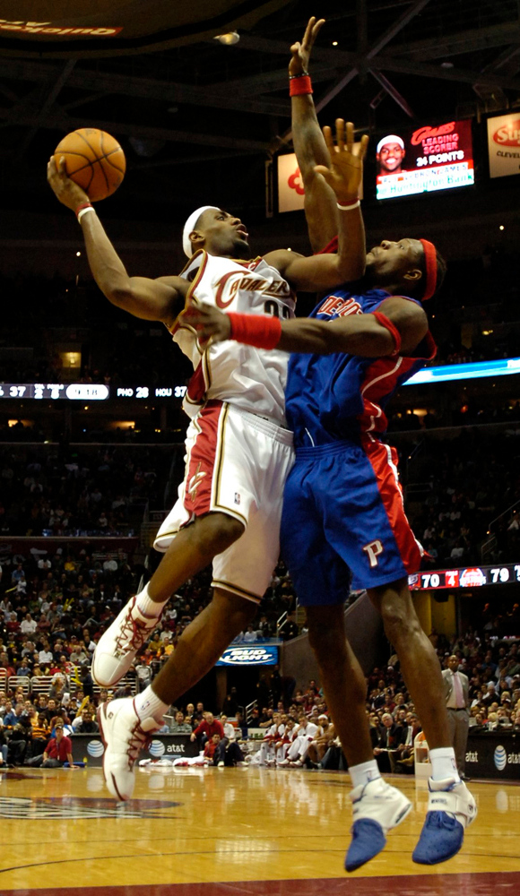 . PHOTO BY DAVID RICHARD Detroit\'s Ben Wallace plays a tight defense on LeBron James of Cleveland last night in the fourth quarter.