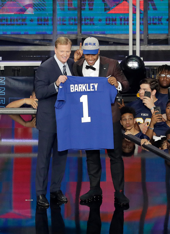 . Penn State\'s Saquon Barkley, right, poses with commissioner Roger Goodell after being selected by the New York Giants during the first round of the NFL football draft, Thursday, April 26, 2018, in Arlington, Texas. (AP Photo/Eric Gay)