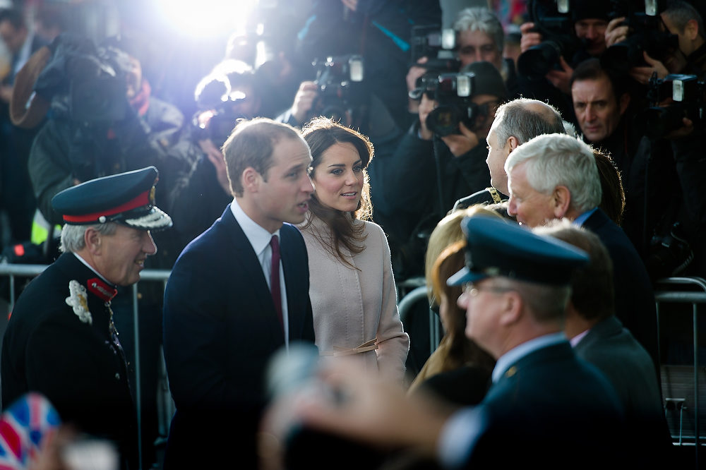 . Britain\'s Prince William, Duke of Cambridge (L) and Britain\'s Catherine, Duchess of Cambridge (R) speak to dignitaries as they arrive for a visit to Peterborough City Hospital in Peterborough, Cambridgeshire, north of London, on November 28, 2012. Britain\'s Prince William and his wife Catherine visited the university city that is home to their dukedom on November 28 for the first time since they were given their official titles.  LEON NEAL/AFP/Getty Images