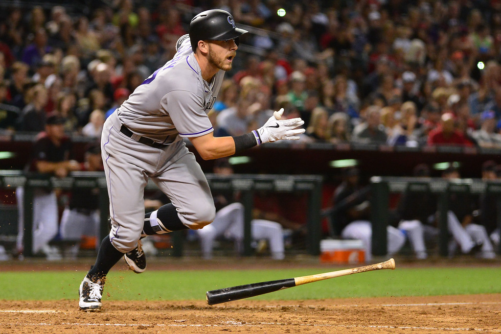 . Trevor Story #27 of the Colorado Rockies hits a two run RBI triple in the ninth inning against the Arizona Diamondbacks at Chase Field on April 30, 2016 in Phoenix, Arizona.  (Photo by Jennifer Stewart/Getty Images)