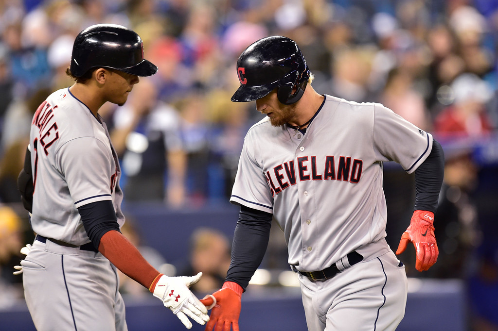 . Cleveland Indians\' Brandon Barnes, right, celebrates his solo home run with teammate Erik Gonzalez (9) during seventh-inning baseball game action against the Toronto Blue Jays in Toronto, Sunday, Sept. 9, 2018. (Frank Gunn)