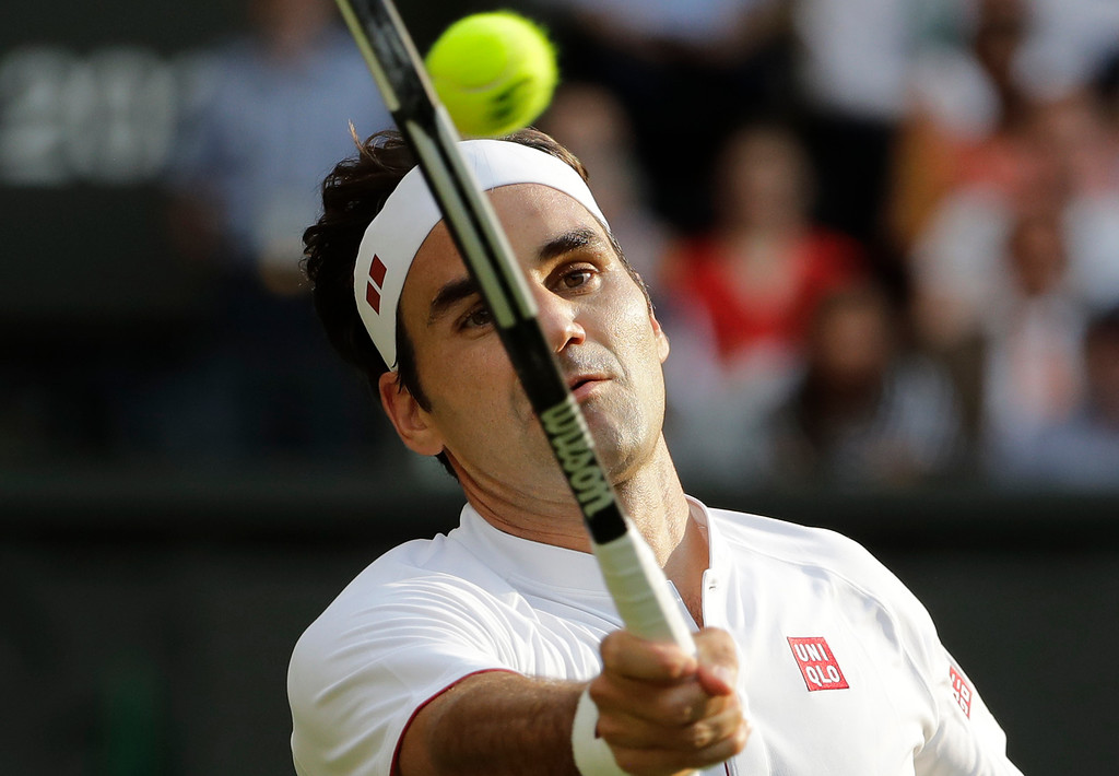 . Switzerland\'s Roger Federer returns the ball to Germany\'s Jan-Lennard Struff during their men\'s singles match, on the fifth day of the Wimbledon Tennis Championships in London, Friday July 6, 2018. (AP Photo/Ben Curtis)