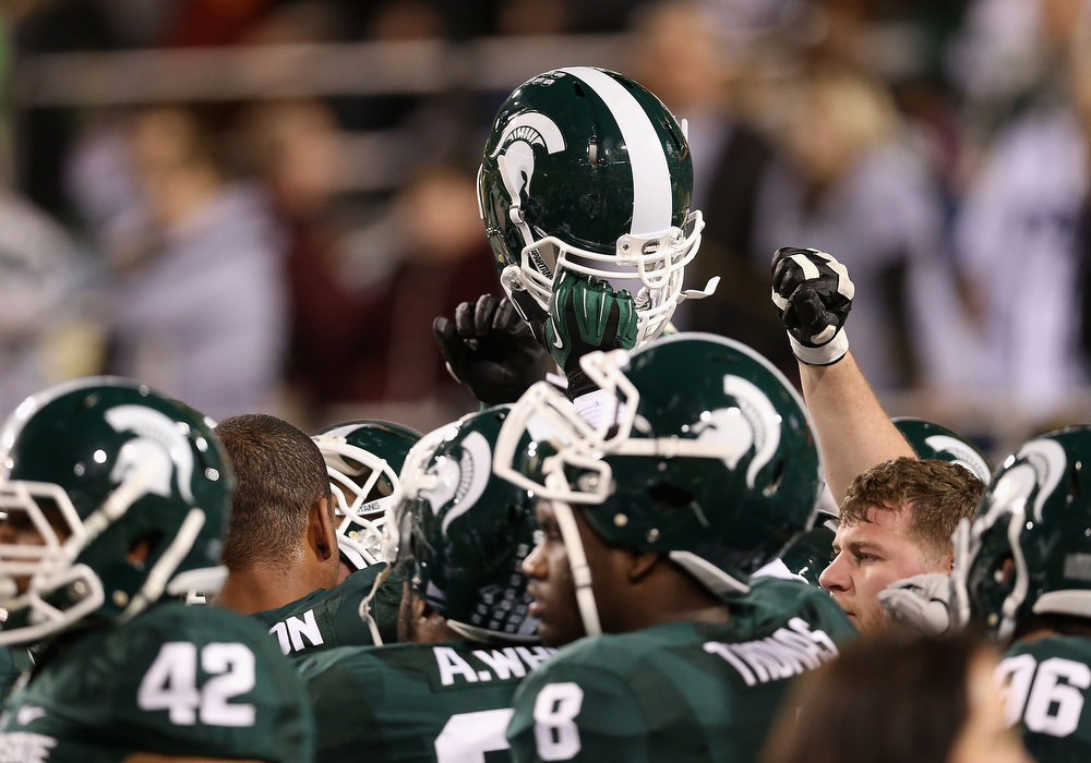 Description of . The Michigan State Spartans huddle up before the Buffalo Wild Wings Bowl against the TCU Horned Frogs at Sun Devil Stadium on December 29, 2012 in Tempe, Arizona.  (Photo by Christian Petersen/Getty Images)