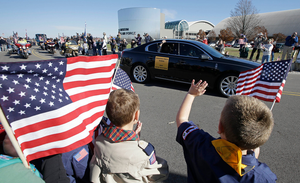 . David Thatcher, one of the four surviving members of the 1942 raid on Tokyo led by Lt. Col. Jimmy Doolittle, waves from a car as he arrives at the National Museum of the US Air Force, Saturday, Nov. 9, 2013, in Dayton, Ohio. Three of the four surviving members of the WWII raid came for a final toast in the evening. (AP Photo/Al Behrman)