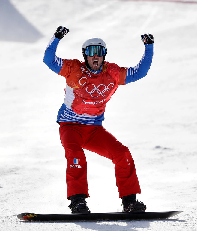 . Pierre Vaultier, of France, celebrates winning the gold medal after the men\'s snowboard cross final at Phoenix Snow Park at the 2018 Winter Olympics in Pyeongchang, South Korea, Thursday, Feb. 15, 2018. (AP Photo/Gregory Bull)