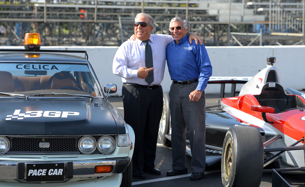 . Mayor Bob Foster, left, and Grand Prix Association of Long Beach President & CEO Jim Michaelian kick off the first full day of LBGP track construction in Long Beach, CA on Tuesday, February 11, 2014. Foster and Michaelian pulled up to the event in a 1975 and 2014 Toyota pace cars. The 40th anniversary of the race with take place April 11-13 on the 1.97-mile course. (Photo by Scott Varley, Daily Breeze)