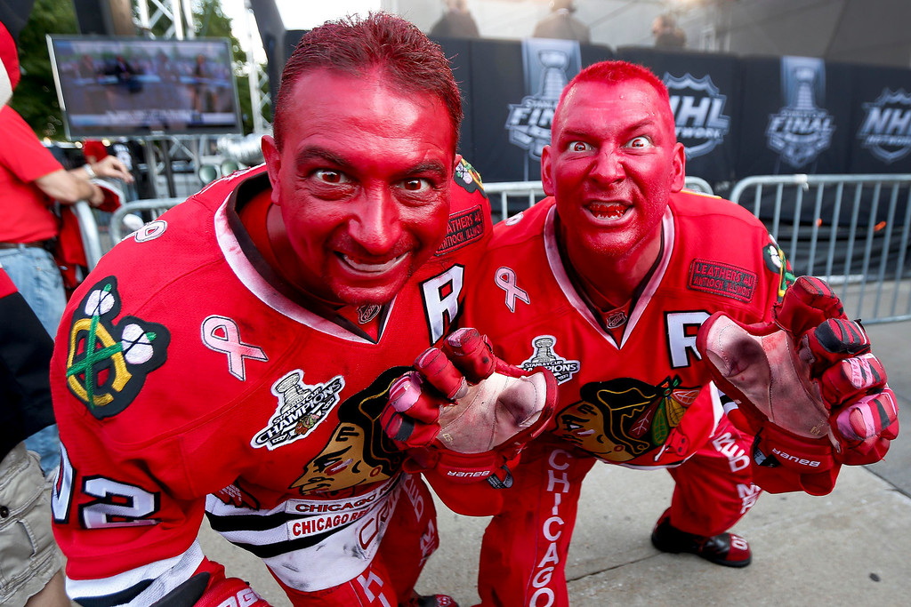 . Painted red in support of the Chicago Blackhawks, Dan Raciak Dominic Randazzo pose for a photo outside the United Center before game 2 of the NHL hockey Stanley Cup Finals against the Boston Bruins, Saturday, June 15, 2013, in Chicago. (AP Photo/Nam Y. Huh)