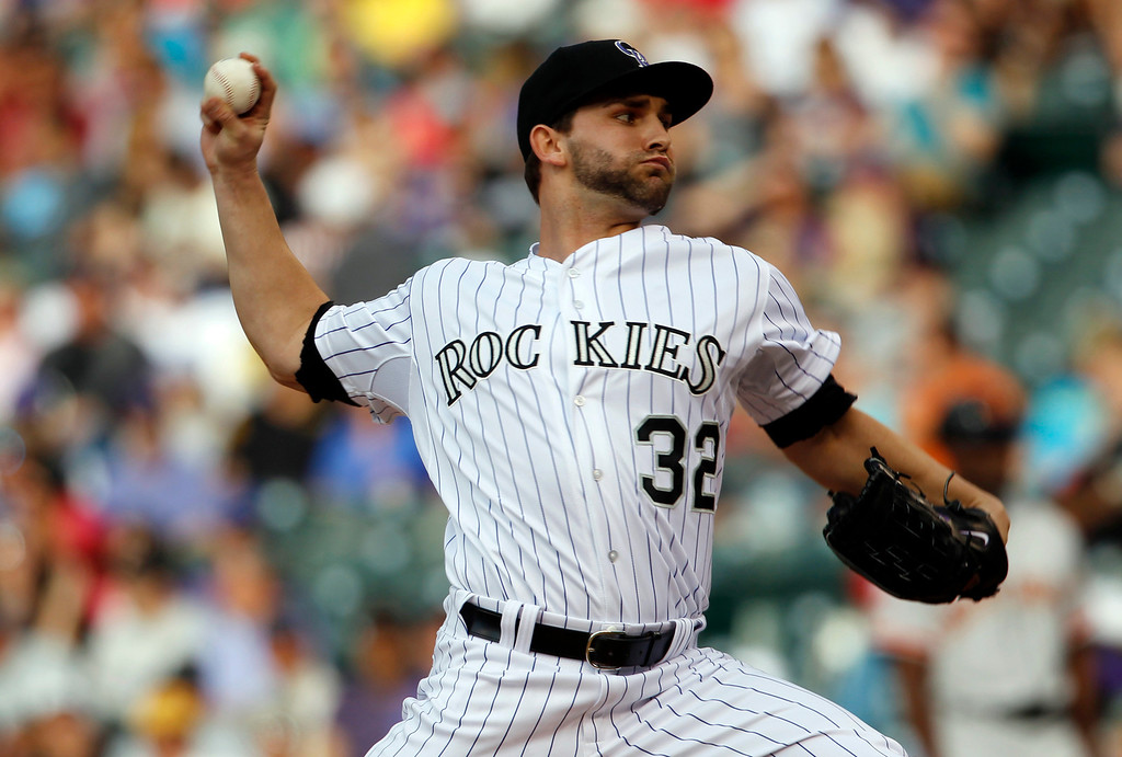 . Colorado Rockies starting pitcher Tyler Chatwood works against the San Francisco Giants in the first inning of a baseball game in Denver, Saturday, May 18, 2013. (AP Photo/David Zalubowski)