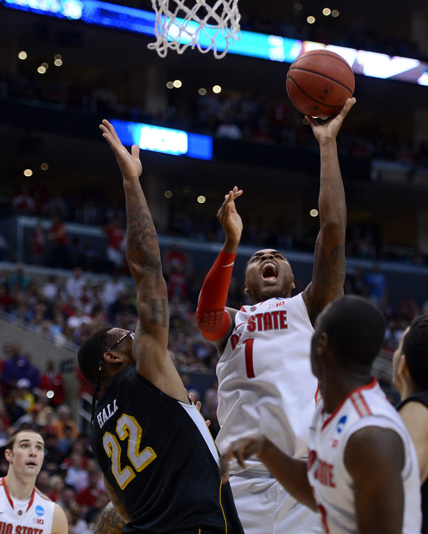 . Deshaun Thomas #1 of the Ohio State Buckeyes goes up for a shot and is fouled by Carl Hall #22 of the Wichita State Shockers in the second half during the West Regional Final of the 2013 NCAA Men\'s Basketball Tournament at Staples Center on March 30, 2013 in Los Angeles, California.  (Photo by Harry How/Getty Images)