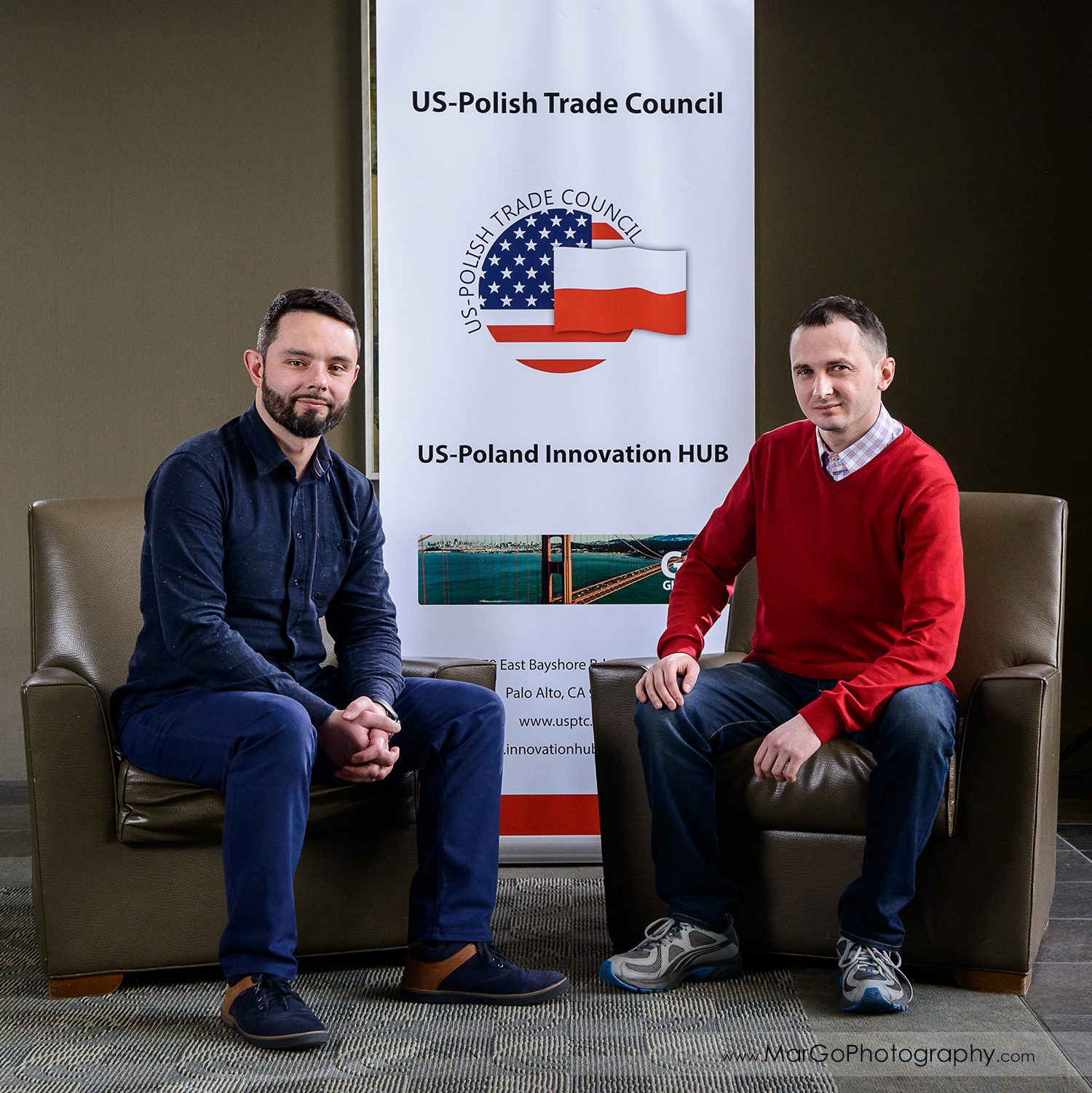 business portrait of two men sitting on the chairs