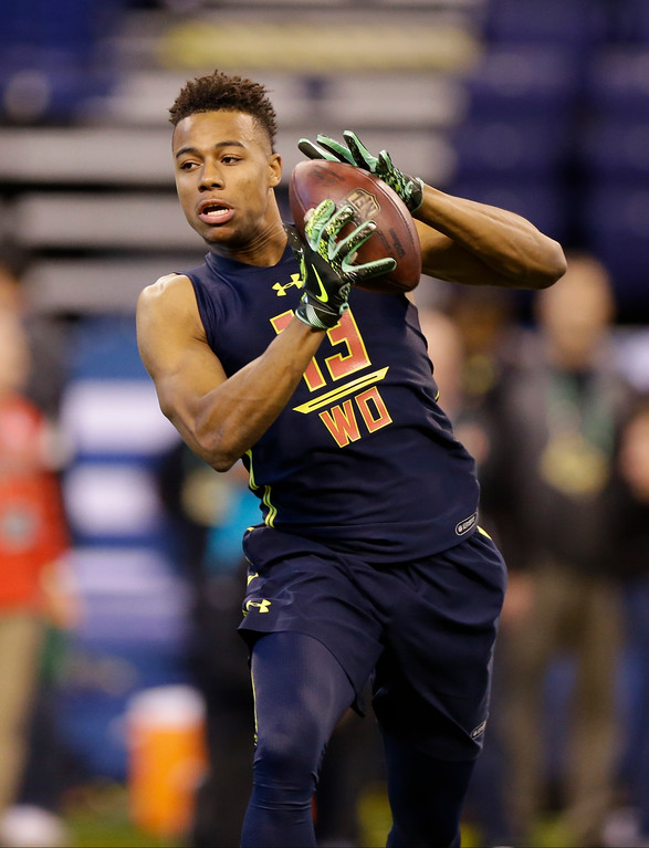 . LSU wide receiver Malachi Dupre runs a drill at the NFL football scouting combine in Indianapolis, Saturday, March 4, 2017. (AP Photo/Michael Conroy)