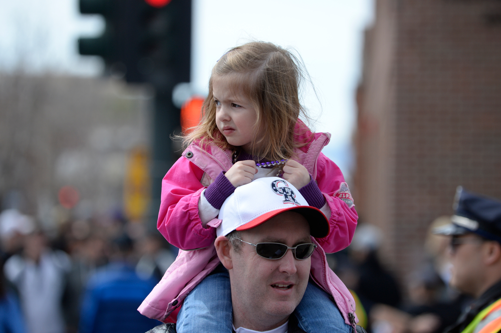 . Nick Smith of Aurora carries his daughter Chloe into the stadium for her third home opener. The Colorado Rockies hosted the Arizona Diamondbacks in the Rockies season home opener at Coors Field in Denver, Colorado Friday, April 4, 2014. (Photo by Craig F. Walker/The Denver Post)