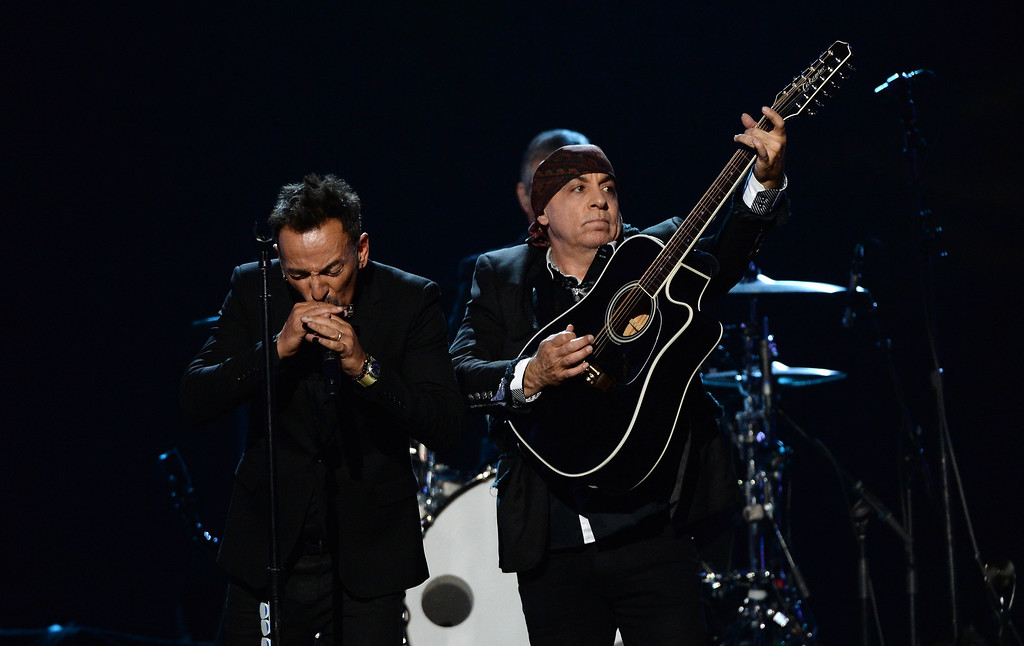 . Bruce Springsteen and inductee Steven Van Zandt of the E Street Band perform onstage at the 29th Annual Rock And Roll Hall Of Fame Induction Ceremony at Barclays Center of Brooklyn on April 10, 2014 in New York City.  (Photo by Larry Busacca/Getty Images)