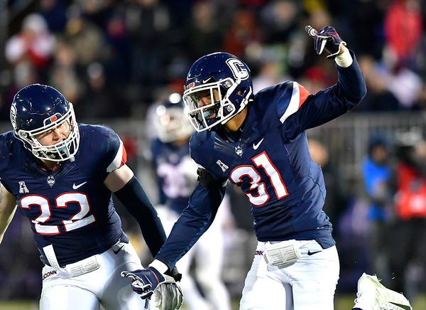 11/24/2018 Mike Orazzi | Staff UConn's Eli Thomas (22) and Oneil Robison (31) during Saturday's football game at Rentschler Field in East Hartford.
