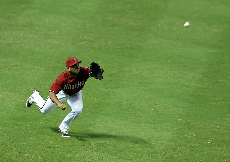 . Outfielder Alfredo Marte #17 of the Arizona Diamondbacks makes a diving catch against the Colorado Rockies during the tenth inning of the MLB game at Chase Field on August 10, 2014 in Phoenix, Arizona. The Rockies defeated the Diamondbacks 5-3 in 10 innings. (Photo by Christian Petersen/Getty Images)