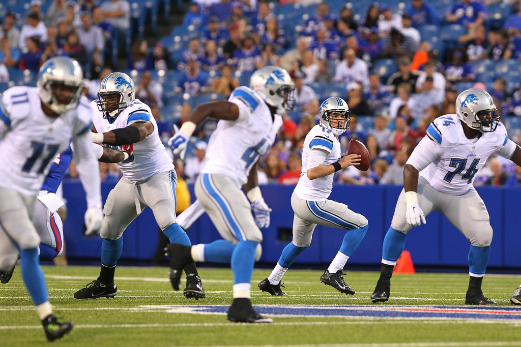 . Detroit Lions quarterback Kellen Moore, second from right, looks to pass against the Buffalo Bills during the first half of a preseason NFL football game, Thursday, Aug. 28, 2014, in Orchard Park, N.Y. (AP Photo/Bill Wippert)