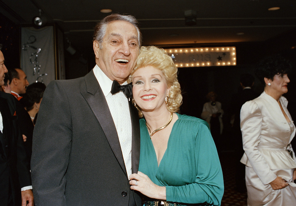 . Debbie Reynolds with Danny Thomas arrives at the Century Plaza Hotel in Los Angeles on Oct. 14, 1985, to attend the Thalians 30th Anniversary Ball in which actress Lana Turner was honored. (AP Photo/Nick Ut)