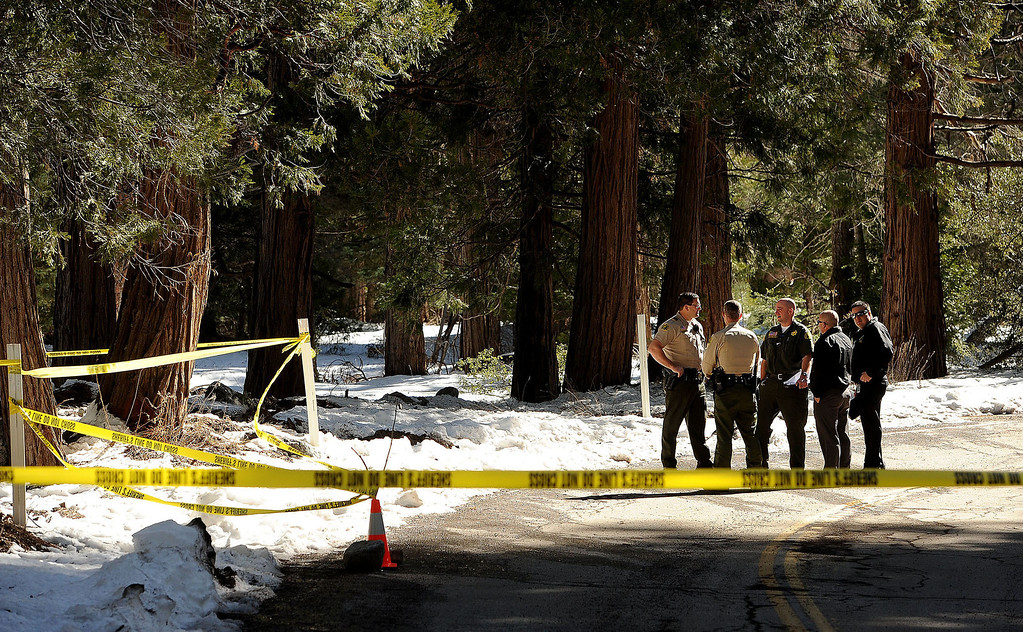 . San Bernardino County Sheriff\'s Deputies collected what is believed to be handgun and silencer belonging to fugitive Christopher Dorner from an area along Glass Road as seen in Seven Oaks February 15, 2013. (Staff photo by Gabriel Luis Acosta/The Sun)