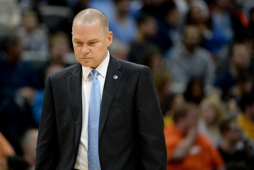 . Michael Malone of the Denver Nuggets stands alone as his team takes a timeout against the Charlotte Hornets during the first quarter. The Denver Nuggets hosted the Charlotte Hornets at the Pepsi Center on Sunday, January 10, 2016. (Photo by AAron Ontiveroz/The Denver Post)