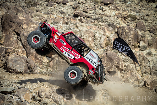 Mel Wade III in EVO1 midair doing a barrel roll during the Qualifying round at the 2015 Ultra4 King of the Hammers, Johnson Valley, California
