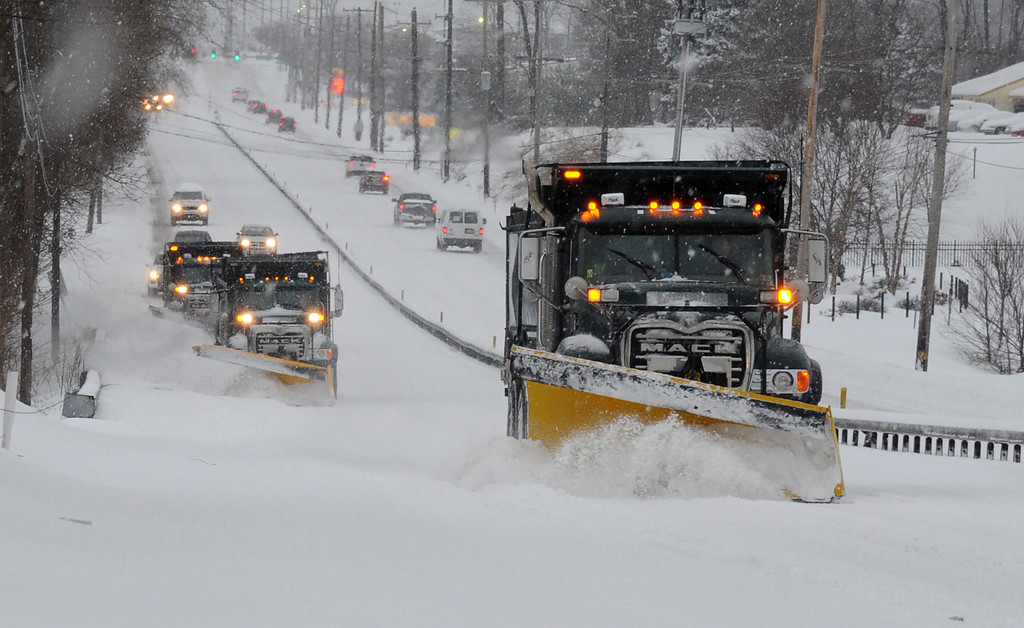 . A plow train heads south on Route 202 between Dilworthtown Road and Route 1 in Birmingham Township on Thursday, Feb. 13, 2014.  The latest storm  during a relentless and frigid winter spread heavy snow and sleet over the mid-Atlantic and the Northeast on Thursday.  (AP Photo/Philadelphia Inquirer, Clem Murray)